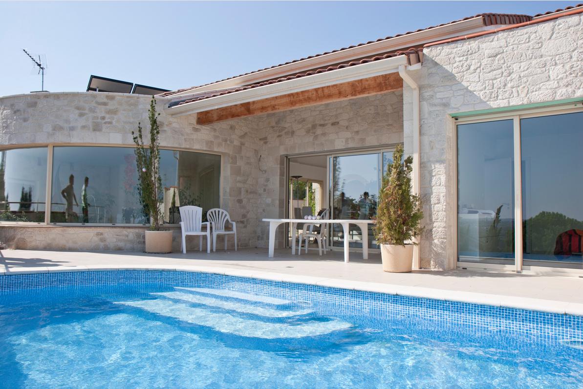 Construction d'une maison avec sa piscine à débordement à Pech-David